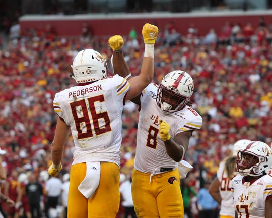 ULM tight end Josh Pederson (86) and running back Josh Johnson (8) celebrate after a touchdown against the Iowa State Cyclones at Jack Trice Stadium.