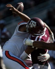 Auburn defensive lineman Derrick Brown (5) forces Texas A&M quarterback Kellen Mond (11) to fumble the ball at Kyle Field in College Station, Texas, on Saturday, Sept. 21, 2019. Auburn defeated Texas A&M 28-20.