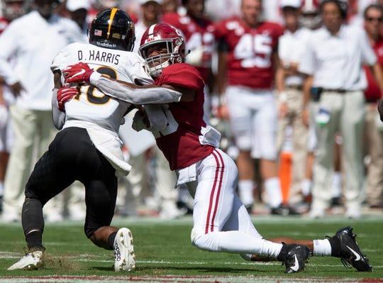Alabama defensive back Josh Jobe (28) stops Southern Miss receiver De'Michael Harris (18) at Bryant-Denny Stadium in Tuscaloosa, Ala., on Saturday September 21, 2019.