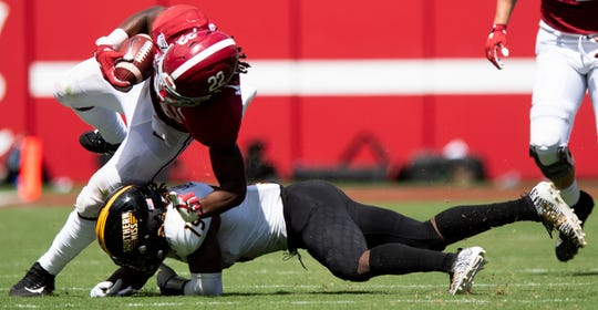 Alabama running back Najee Harris (22) avoids the tackle of Southern Miss defensive back Ky'el Hemby (19) at Bryant-Denny Stadium in Tuscaloosa, Ala., on Saturday September 21, 2019.