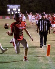 Lowndes' Trevor Haney strolls into the end zone scoring a touchdown.