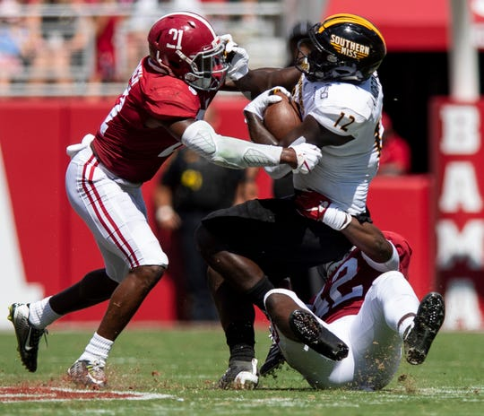 Alabama defensive back Jared Mayden (21) and linebacker Jaylen Moody (42) stop Southern Miss running back Steven Anderson (12) at Bryant-Denny Stadium in Tuscaloosa, Ala., on Saturday September 21, 2019.