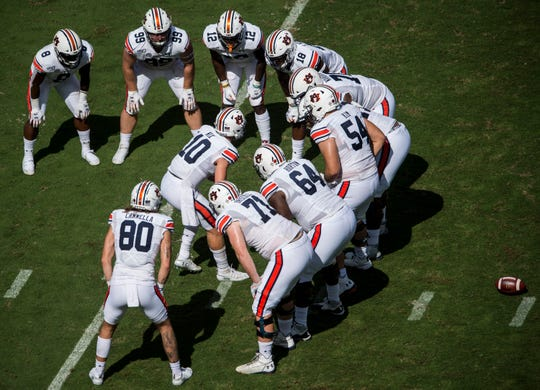 Auburn quarterback Bo Nix (10) huddles with the offense against Texas A&M at Kyle Field in College Station, Texas, on Saturday, Sept. 21, 2019.