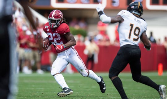 Alabama running back Najee Harris (22) carries the ball against Southern Miss at Bryant-Denny Stadium in Tuscaloosa, Ala., on Saturday September 21, 2019.