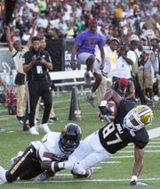 ASU wide receiver Ismail Saleem (87) catches a pass and is brought down by Grambling's Kenan Fotentot.