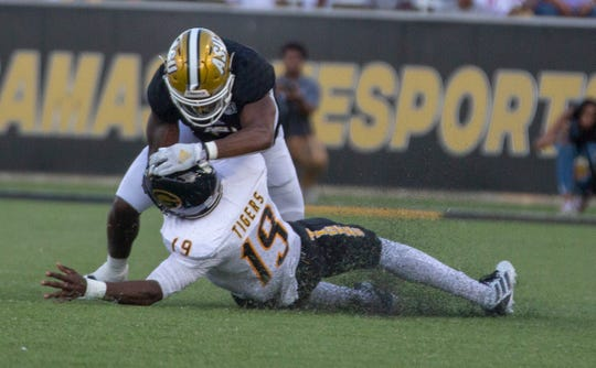 ASU defensive back Joshua Hill (24) brings down Grambling quarterback Geremy Hickbottom resulting in a targeting call and an ejection.