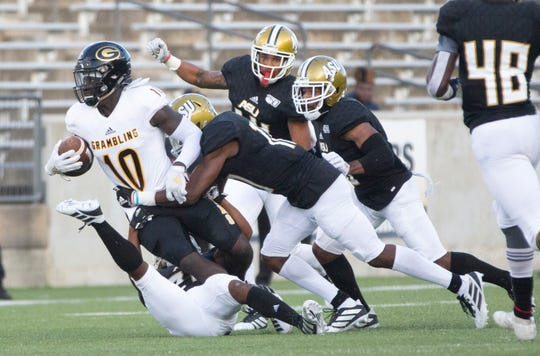 Grambling's Lyndon Rash is brought down during a play in the first half.