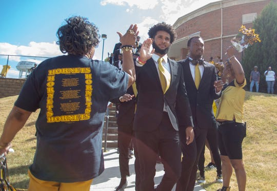 Hornets fans welcome the ASU football team to the stadium before kickoff against Grambling.