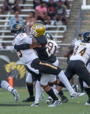 ASU defensive back Aaron Pope (27) brings down Grambling quarterback Heremy Hickbottom resulting in a fumble.