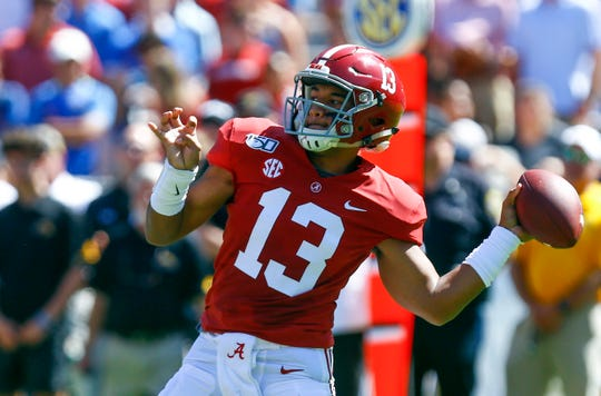 Sep 21, 2019; Tuscaloosa, AL, USA; Alabama Crimson Tide quarterback Tua Tagovailoa (13) throws a pass for a touchdown during the first half of an NCAA college football game against Southern Mississippi at Bryant-Denny Stadium. Mandatory Credit: Butch Dill-USA TODAY Sports