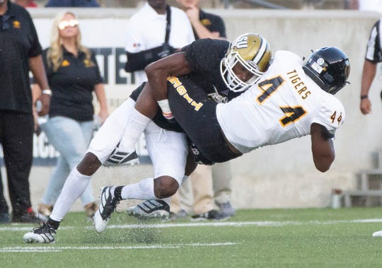 Grambling's Jakarie Nichols is brought down during a play in the first half.