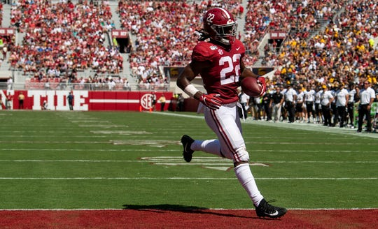 Alabama running back Najee Harris (22) carries a reception into the end zone for a touchdown against Southern Miss vat Bryant-Denny Stadium in Tuscaloosa, Ala., on Saturday September 21, 2019.