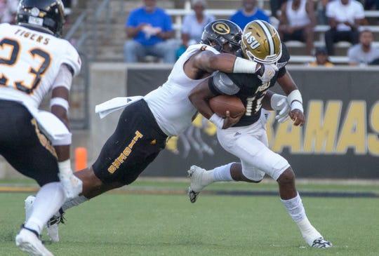 Grambling's Anfernee Mullins takes down ASU quarterback Kha'Darris Davis (12).