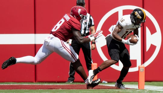 Southern Miss' De'Michael Harris scores a touchdown against Alabama linebacker Christian Harris (8) at Bryant-Denny Stadium in Tuscaloosa, Ala., on Saturday September 21, 2019.