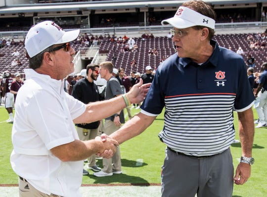 Texas A&M head coach Jimbo Fisher and Auburn head coach Gus Malzahn shake hands during warm ups at Kyle Field in College Station, Texas, on Saturday, Sept. 21, 2019.