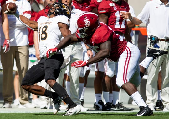 Alabama linebacker Shane Lee (35) breaks up a pass intended for Southern Miss De'Michael Harris (18)at Bryant-Denny Stadium in Tuscaloosa, Ala., on Saturday September 21, 2019.
