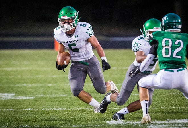 New Castle's Tytus Ragle runs with the ball during the Trojans' game against Yorktown at Yorktown High School on Sept. 20, 2019.