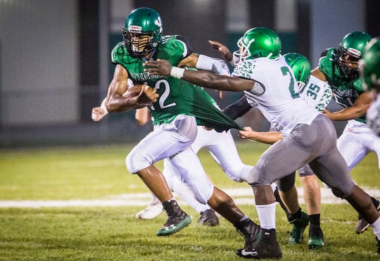 Yorktown's Jamarius Evans breaks through New Castle defenders during their homecoming game at Yorktown High School Friday, Sept. 20, 2019.