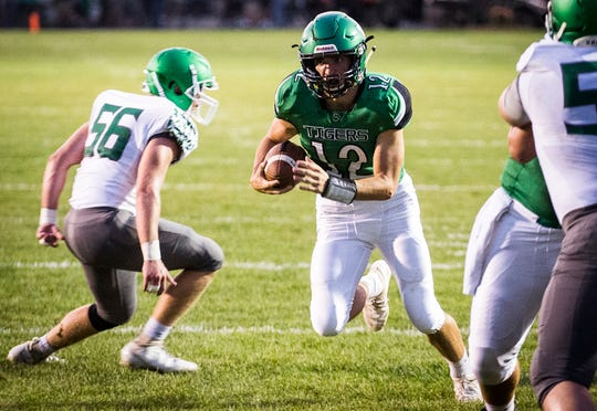 Yorktown's Reid Neal runs the ball against New Castle during their game at Yorktown High School Friday, Sept. 20, 2019.