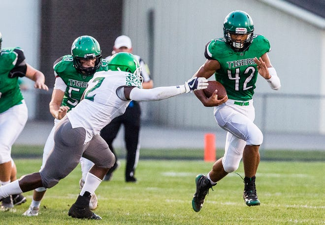 FILE -- Yorktown's Jamarius Evans runs the ball against New Castle during their game at Yorktown High School on Sept. 20, 2019.