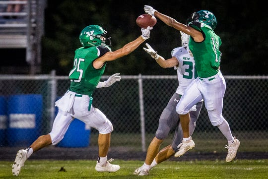 FILE -- Yorktown's Austin Hill defends a New Castle pass during their game at Yorktown High School Friday, Sept. 20, 2019.