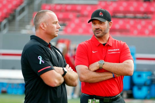 North Carolina State head coach Dave Doeren, left, speaks with Ball State head coach Mike Neu prior to an NCAA college football game in Raleigh, N.C., Saturday, Sept. 21, 2019. (AP Photo/Karl B DeBlaker)