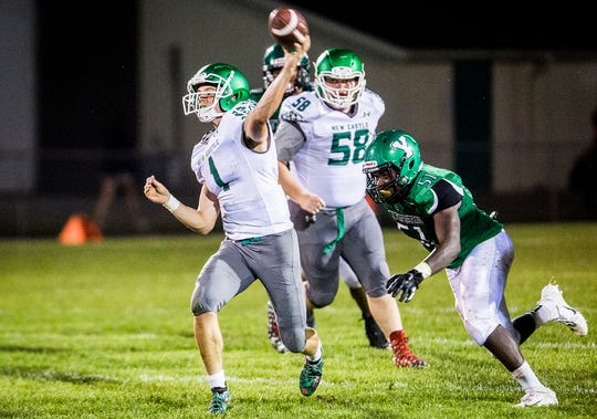New Castle's William Grieser passes against Yorktown during their game at Yorktown High School Friday, Sept. 20, 2019.