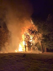 Firefighters from four departments battled a house blaze in northwestern Delaware County early Saturday