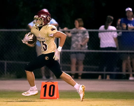 Riverdale's CJ Johnson (25) runs the ball in for a touchdown during the game against Rockvale on Friday Sept. 20, 2019, at Riverdale.