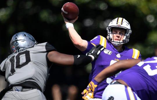 LSU quarterback Joe Burrow (9) throws a pass past Vanderbilt defensive lineman Dayo Odeyingbo (10) in the second quarter during their game at Vanderbilt Stadium Saturday, Sept. 21, 2019 in Nashville , Tenn. .