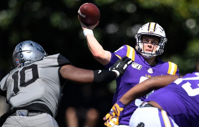 1. Cincinnati Bengals: Joe Burrow, QB, LSU -- Quarterback Joe Burrow (9) throws a pass past Vanderbilt defensive lineman Dayo Odeyingbo (10) in the second quarter during their game at Vanderbilt Stadium Saturday, Sept. 21, 2019 in Nashville , Tenn. .