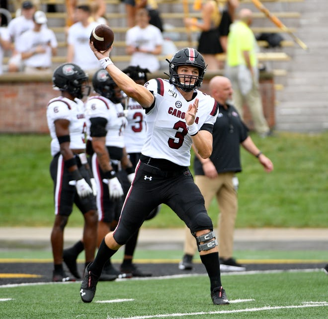 South Carolina Gamecocks quarterback Ryan Hilinski (3) warms up before the game against the Missouri Tigers at Memorial Stadium/Faurot Field.