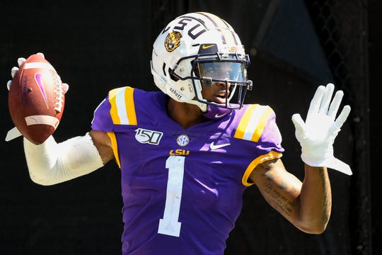 LSU wide receiver Ja'Marr Chase (1) reacts to scoring a touchdown against Vanderbilt during the second half at Vanderbilt Stadium in Nashville, Tenn., Saturday, Sept. 21, 2019.