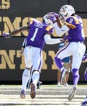 LSU wide receiver Ja'Marr Chase (1) celebrates scoring a touchdown against Vanderbilt with wide receiver Justin Jefferson (2) during the first half at Vanderbilt Stadium in Nashville, Tenn., Saturday, Sept. 21, 2019.