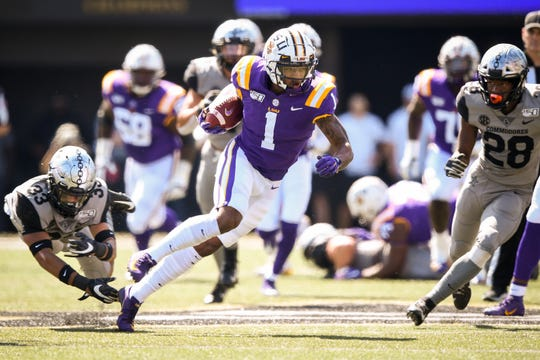 LSU wide receiver Ja'Marr Chase (1) runs in a touchdown against Vanderbilt during the first half at Vanderbilt Stadium in Nashville, Tenn., Saturday, Sept. 21, 2019.