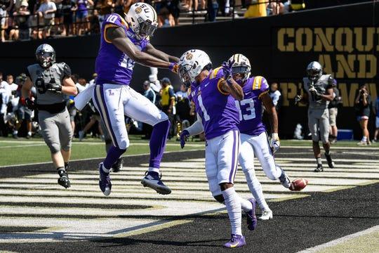 LSU wide receiver Ja'Marr Chase (1) celebrates his touchdown against Vanderbilt with tight end Stephen Sullivan (10) during the first half at Vanderbilt Stadium in Nashville, Tenn., Saturday, Sept. 21, 2019.