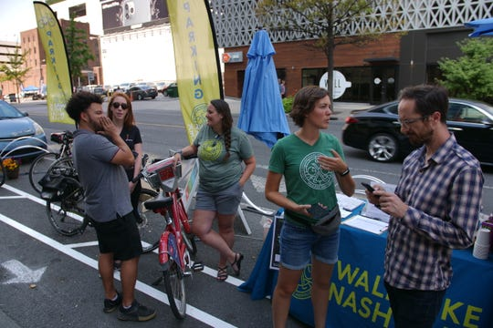 Nora Kern, executive director of Walk Bike Nashville, talks to District 19 Metro Councilman Freddie O'Connell at a makeshift bike lane on Commerce Street and Third Avenue on Friday, Sept. 20, 2019.