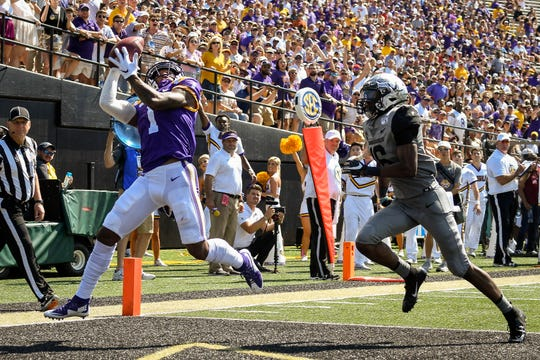 LSU wide receiver Ja'Marr Chase (1) scores a touchdown past Vanderbilt defensive back BJ Anderson (16) during the second half at Vanderbilt Stadium in Nashville, Tenn., Saturday, Sept. 21, 2019.