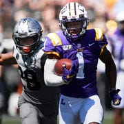 LSU wide receiver Ja'Marr Chase (1) races past Vanderbilt defensive back Allan George (28) for a touchdown in the second quarter during their game at Vanderbilt Stadium Saturday, Sept. 21, 2019 in Nashville , Tenn. .