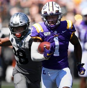 LSU wide receiver Ja'Marr Chase (1) races past Vanderbilt defensive back Allan George (28) for a touchdown in the second quarter during their game at Vanderbilt Stadium Saturday, Sept. 21, 2019 in Nashville , Tenn. .