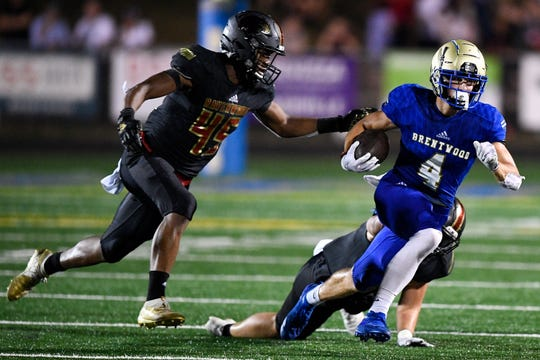 Brentwood's Walker Merrill (4) is chased by Ravenwood's Junior Colson (45) during the second half at Brentwood High School in Brentwood, Tenn., Friday, Sept. 20, 2019.