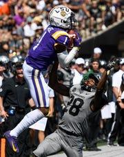 LSU wide receiver Ja'Marr Chase (1) receives a pass over Vanderbilt defensive back Allan George (28) during the first half at Vanderbilt Stadium in Nashville, Tenn., Saturday, Sept. 21, 2019.