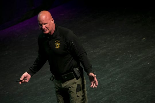 Scott Griffith, a staff officer with the Lee County Sheriff's Office Community Response Unit, speaks at an event called, Active Threat: Prevention and Response for Parents, on Saturday, Sept. 21, 2019, at Barbara B. Mann Performing Arts Hall in Fort Myers.