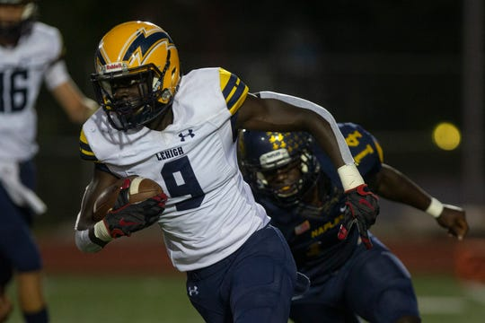 Lehigh Senior High School's Richard Young carries the ball against Naples High School, Friday, Sept. 20, 2019, at Staver Field in Naples.