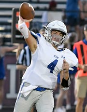 Community School of Naples quarterback Cooper Chur plays against First Baptist Academy on Friday night. Chur, the center last year, won the starting job after Dylan McNamara transferred to St. Thomas Aquinas in the summer.