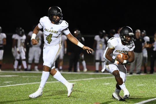 Paramus Catholic football at Hackensack on Friday, September 20, 2019. PC #4 QB Dorian Nowell hands the ball off to #6 Jahsim	Brooks in the third quarter.