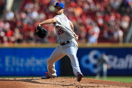 Sep 21, 2019; Cincinnati, OH, USA; New York Mets starting pitcher Zack Wheeler (45) throws against the Cincinnati Reds in the first inning at Great American Ball Park.