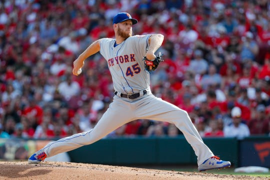 New York Mets starting pitcher Zack Wheeler throws in the second inning of a game against the Cincinnati Reds, Saturday, Sept. 21, 2019, in Cincinnati.