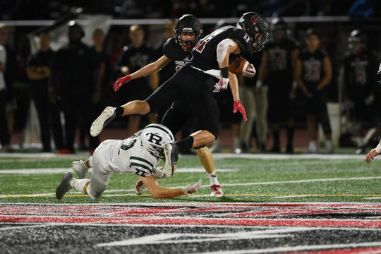 Ramapo football plays Northern Highlands at home in Allendale on Friday September 20, 2019. Ramapo #37 Aidan Labell jumps over Ramapo #22 Jake Tirone.