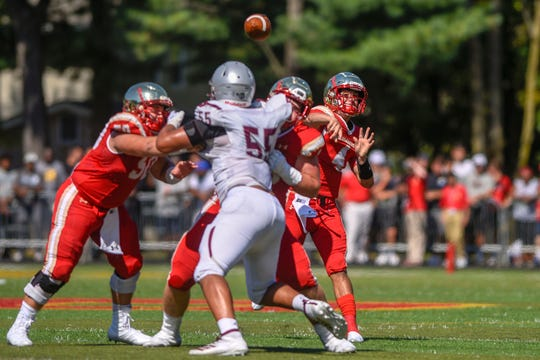 St. Peter's Prep football at Bergen Catholic on Saturday, September 21, 2019. BC #4 QB Andrew Boel throws a pass to #1 Pierson Tobia who ran for a touchdown in the second quarter.